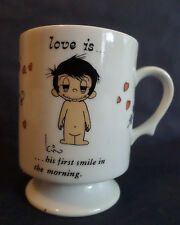 """Love is…his first smile in the morning"" mug, 1972"