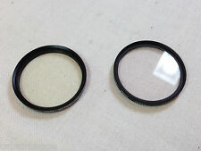 Two 49mm Filters type UV and 1A Skylight - Made in Japan - EX