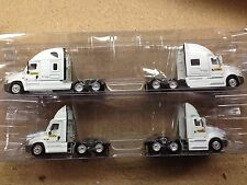 HO 1/87 TNS # 110121 JBI/DCS Tractors (4 pcs.) 2-Freightliners 2-International H