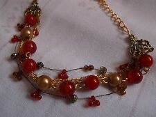BRAND  NEW  FASHONABLE RED AND BRONZE BALLS ON THREE  CHAIN BRACELET
