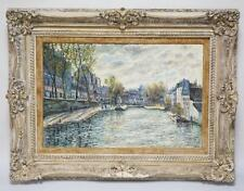 OIL PAINTING ON CANVAS OF A EUROPEAN CITY WITH BOATS IN A CANAL LINE... Lot 1070