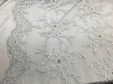 White/silver Snowflake Flower Design Embroider With Sequins On A Mesh Lace.