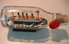 Ship in a Bottle TITANIC with rigging/American Flag.  New Item. Icebergs ahead!
