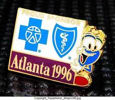 OLYMPIC PINS 1996 ATLANTA GEORGIA USA BLUE CROSS/SHIELD SPONSOR IZZY MASCOT
