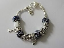 925 silver filled charm bracelet .with charms and beads 18cm
