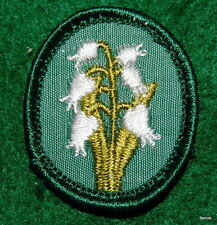 GIRL SCOUT TROOP CREST - PLASTIC  BACK - LILLY OF THE VALLEY