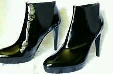 Stuart Weitzman black patent leather platform boots. Sz 9.5 Excellent condition.