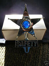 VINTAGE STYLE SAFETY STAR WITH A BLUE GLASS JEWEL IN THE CENTER THAT LIGHTS UP !