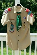 Boy scout shirt with 7 badges and 1 pin