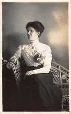 Young lady posed in chair floral boquet studio  BF428