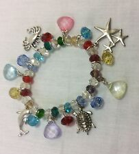 Charm Bracelet with Crystals and Beach Design charms in metal, Purses charms.