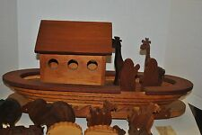 Very beautifully carved wooden Noah's Ark with Noah, his wife and animals