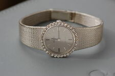 **OMEGA** SUPERBE  MONTRE  FEMME OR BLANC   18 K DIAMANTS
