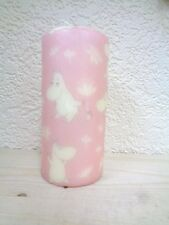 Handmade finished candle with vintage multiple Moomins white pink background