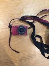 Nikon 1 j2 Fotocamera Digitale-Rosso 10-30mm. 1:3. 5-5.6 VR 40.5