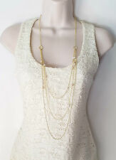 "Gorgeous 40"" long gold tone layered chain necklace with faux pearl bead detail"
