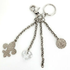 Silver tone key chain with 3 charms, signed KATHY Van Zeeland Lot 52H