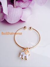 Beautiful 18K gold plated Bracelet with a White Charm Elephant