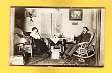 RPPC Man and Woman in Living Room, Elk Painting,wicker furniture DHS pennant