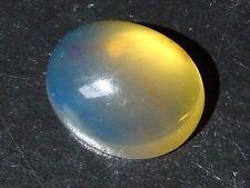 Blauer Bernstein / blue Amber 11,52 Ct. 21,5 mm Cabochon (279x)