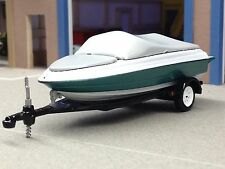 1/64 GREENLIGHT GREEN/WHITE BOAT W/ TRAILER