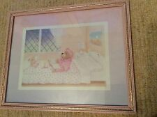 Teddy Bear Sitting on Bed Reading Picture in Pink Frame. Looks unused