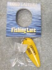 COLLECTABLE LORD CALVERT CANADIAN WHISKEY FISHING LURE YELLOW MADE OF METAL