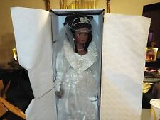 DOLL AS TRINA (TRINA IS IN A WHITE  WEDDING DRESS) COMES WITH DOLL STAND