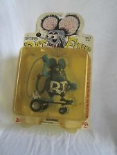 RAT FINK ON SKATEBOARD--new and sealed plastic cover has yellowed over time (BH)