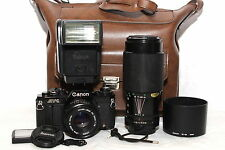 CANON AV-1 Black Reflex Analogica OBIETTIVO FD 50mm 1.8 + FD 70-210mm + FLASH |