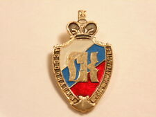 Russian or Cyrillic language pin with crown emblem or crest