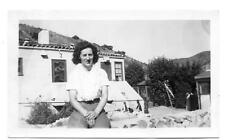 Woman Sitting On A Stone Wall In Front Of Avalon Catalina House Photo 1940s