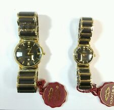 HIS AND HERS ONISS PARIS MATCHING CERAMIC GOLD PLATED WATCHES