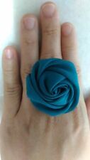 Teal coloured fabric rosette adjustable ring