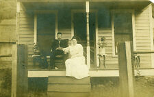 Galeton,PA. Galeton Couple and Dog on Porch 1908 RPPC