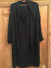 A silky approx size 16 long sleeved dress with a pussy bow neckline no label