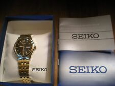 Seiko Solar Mens Black Dial Day/Date Dial Gold Tone Stainless Steel Watch