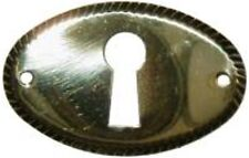 REPAIR PARTS   STAMPED  BRASS OVAL KEY HOLE COVER B0246