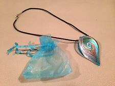 Turquoise rainbow glass necklace in a gift bag