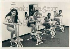 Pretty International Beauty Contestants on Exercise Bicycles Press Photo