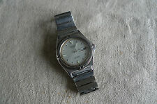 Nice vintage Seiko SQ100 men's wrist watch in good conditions