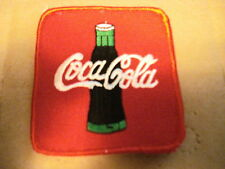 "COCA-COLA WITH BOTTLE  3"" X 3 1/2"" NEW  CLOTHING PATCH"