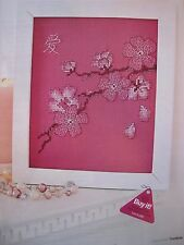 Blackwork cherry blossoms on raspberry fabric - cross stitch chart from magazine