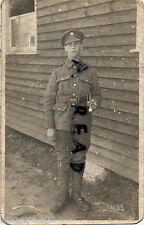 WW1 Private Monmouths Monmouthshire Regiment beside barrack hut