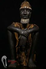 Discover African Art Sitting Dogon Hunter Statue with Hunter's Tunic and Hat