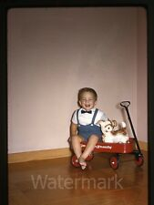 1961 Kodachrome photo slide  Young boy with toy pull wagon