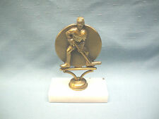 bronze cast metal male ice hockey trophy with marble base