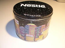 """Vintage Nestle Brand Tin 5 1/2"""" x 6 1'2"""" Shows Their Brands in a City Scene"""