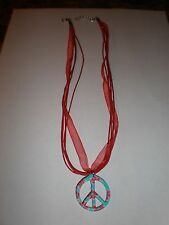 Turquoise with Red floral design peace sign on red ribbon necklace
