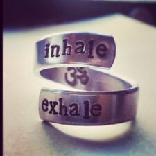 inhale exhale OM symbol  inside aluminum twist meditation , yoga reminder ring